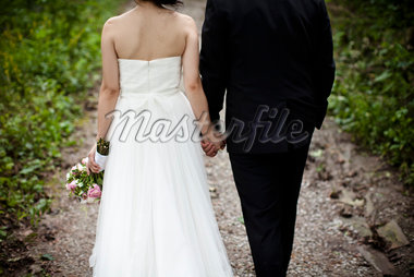 Backview of Bride and Groom Walking down Footpath, Toronto, Ontario, Canada Stock Photo - Premium Rights-Managed, Artist: Ikonica, Code: 700-05756386