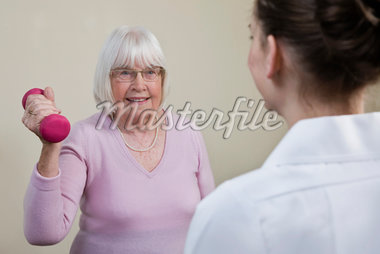 Physio supervises a senior woman exercising Stock Photo - Premium Royalty-Freenull, Code: 618-05761980