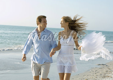 Couple running on beach Stock Photo - Premium Royalty-Freenull, Code: 695-05763147