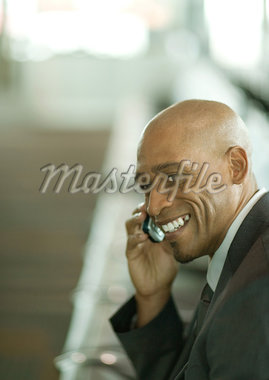 Businessman using cell phone, portrait Stock Photo - Premium Royalty-Freenull, Code: 695-05763947