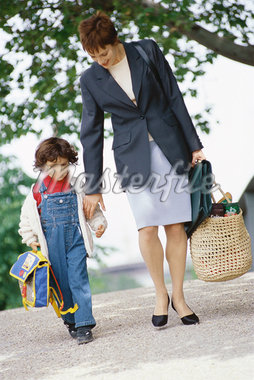 Businesswoman walking with son Stock Photo - Premium Royalty-Freenull, Code: 695-05764599