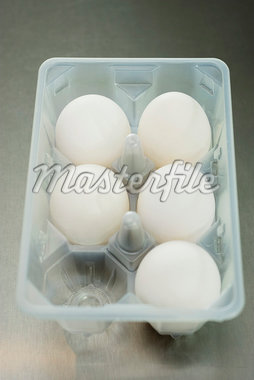 Fresh eggs in carton Stock Photo - Premium Royalty-Freenull, Code: 695-05770942