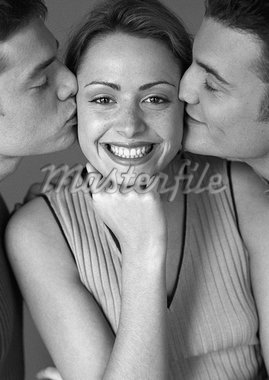 Woman being kissed by two men, portrait, b&w Stock Photo - Premium Royalty-Freenull, Code: 695-05774613