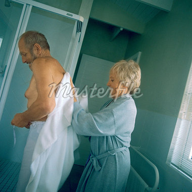Mature woman drying man's bare back, side view Stock Photo - Premium Royalty-Freenull, Code: 695-05775145