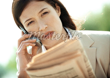 Businesswoman using cell phone, close-up, tilt Stock Photo - Premium Royalty-Freenull, Code: 695-05776287