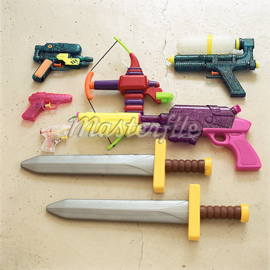 Children's toy swords and guns Stock Photo - Premium Royalty-Freenull, Code: 695-05776543