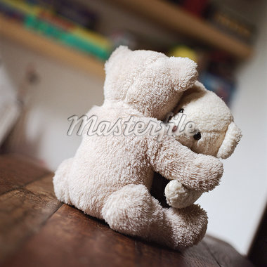 Teddy bears hugging on table Stock Photo - Premium Royalty-Freenull, Code: 695-05776567