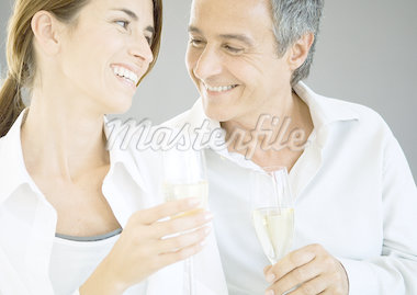 Couple holding champagne flutes Stock Photo - Premium Royalty-Freenull, Code: 695-05778897