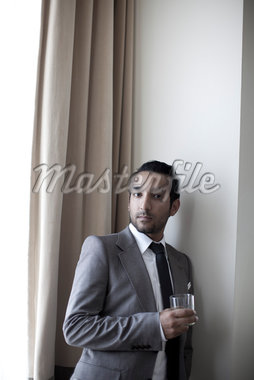 Portrait of Man Holding Drink Stock Photo - Premium Rights-Managed, Artist: Ikonica, Code: 700-05781014