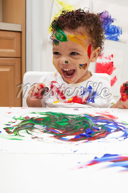 Little Boy Finger Painting Stock Photo - Premium Royalty-Free, Artist: Amy Whitt, Code: 600-05786119