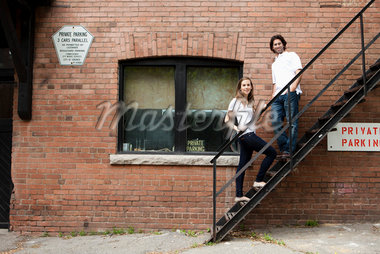 Portrait of Young Couple Standing on Fire Escape in Alleyway, Toronto, Ontario, Canada Stock Photo - Premium Royalty-Free, Artist: Ikonica, Code: 600-05786156