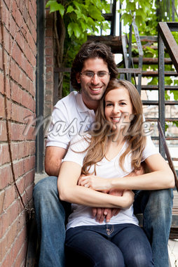 Portrait of Young Couple Sitting on Fire Escape, Toronto, Ontario, Canada Stock Photo - Premium Royalty-Free, Artist: Ikonica, Code: 600-05786158