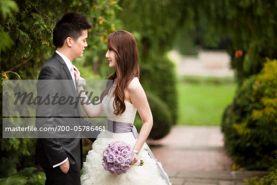 Bride and Groom Outdoors Stock Photo - Premium Rights-Managed, Artist: Ikonica, Code: 700-05786461