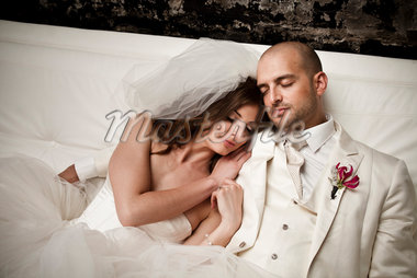 Bride and Groom Cuddling Stock Photo - Premium Rights-Managed, Artist: Ikonica, Code: 700-05786475
