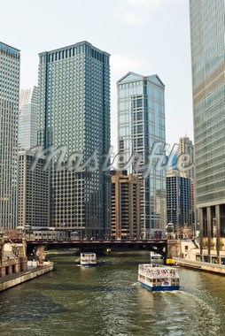 City skyline with river and boats Stock Photo - Premium Royalty-Freenull, Code: 6106-05787454