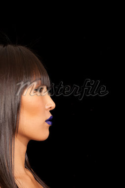 Side view of beautiful woman against black background Stock Photo - Premium Royalty-Freenull, Code: 693-05794119