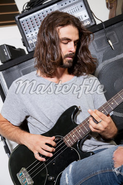Male musician playing guitar Stock Photo - Premium Royalty-Freenull, Code: 693-05794453
