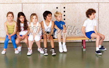 Young schoolchildren sitting on bench in gym Stock Photo - Premium Royalty-Freenull, Code: 618-05800347