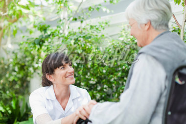 Nurse talking to older patient outdoors Stock Photo - Premium Royalty-Freenull, Code: 649-05801279