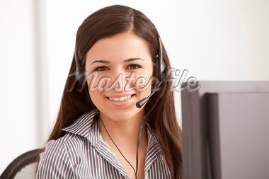 Businesswoman talking on headset at desk Stock Photo - Premium Royalty-Freenull, Code: 649-05802053