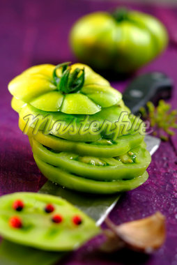 Slicing a green tomato Stock Photo - Premium Royalty-Freenull, Code: 652-05808160