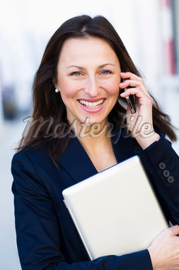 Businesswoman talking on cell phone Stock Photo - Premium Royalty-Freenull, Code: 649-05819775