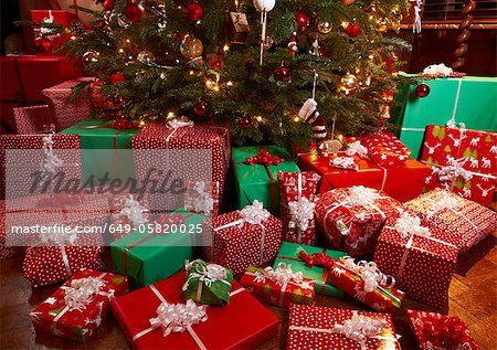 Lots Of Christmas Presents Under Tree