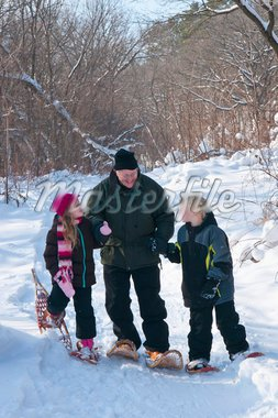 Grandfather and two grandchildren snowshoeing in a snowy forest, Rochester, Minnesota, United States of America, North America Stock Photo - Premium Rights-Managed, Artist: Robert Harding Images, Code: 841-05847765
