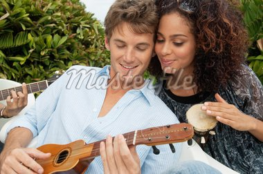 Couple playing musical instruments Stock Photo - Premium Royalty-Freenull, Code: 6108-05863664