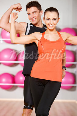 Sporty couple exercising at the fitness gym Stock Photo - Royalty-Free, Artist: dash                          , Code: 400-05875364
