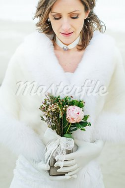beautiful young bride with a wedding bouquet Stock Photo - Royalty-Free, Artist: macsim                        , Code: 400-05875946