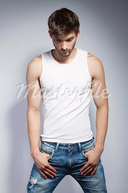 young beautiful man in white t-shirt posing Stock Photo - Royalty-Free, Artist: mast3r                        , Code: 400-05876062
