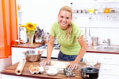 Lovely young woman making cake in the kitchen Stock Photo - Royalty-Free, Artist: kalozzolak                    , Code: 400-05876864