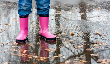Child standing in a puddle wearing a rubber boots. Stock Photo - Royalty-Free, Artist: Aleksan                       , Code: 400-05881694