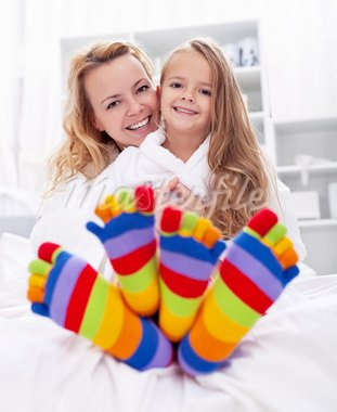 Happy girl and woman at home after bath wearing colorful socks Stock Photo - Royalty-Free, Artist: ilona75                       , Code: 400-05882458