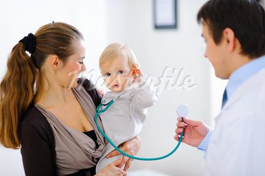 Cute baby on mamas hand playing with stethoscope    Stock Photo - Royalty-Free, Artist: citalliance                   , Code: 400-05883606