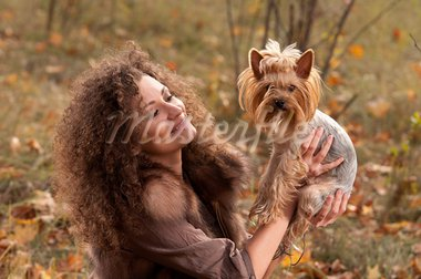 woman with curls and a little dog in nature, fall Stock Photo - Royalty-Free, Artist: artfotoss                     , Code: 400-05886000
