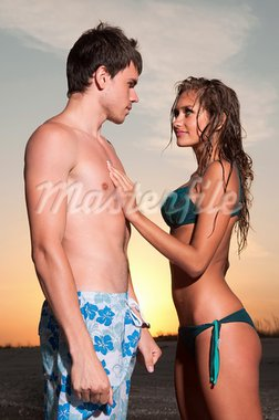guy and his girlfriend are on the beach Stock Photo - Royalty-Free, Artist: artfotoss                     , Code: 400-05886002