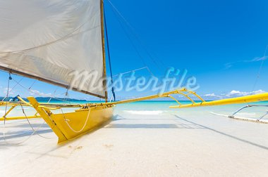 traditional paraw sailing boats on white beach on boracay island, Philippines Stock Photo - Royalty-Free, Artist: hansenn                       , Code: 400-05899344