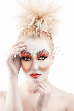 Portrait of young woman with colorful creative make-up like a doll and very cute hair style. she is in front of the camera, looks in to the lens and has both hands near the face Stock Photo - Royalty-Free, Artist: carlodapino                   , Code: 400-05901556
