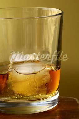 glass of scotch whiskey and ice on gold  background Stock Photo - Royalty-Free, Artist: Dream79                       , Code: 400-05902029