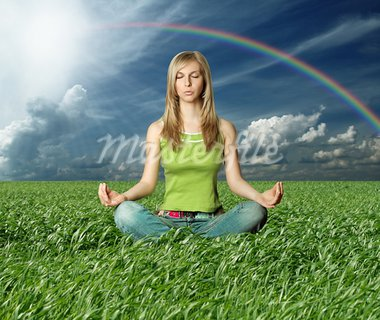 Blonde in lotus pose in green grass on blue summer sky Stock Photo - Royalty-Free, Artist: leedsn                        , Code: 400-05902754
