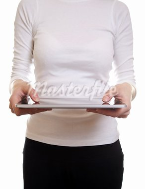 Woman using a digital tablet on white Stock Photo - Royalty-Free, Artist: tommyandone                   , Code: 400-05906083