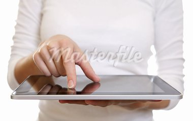 Woman using a digital tablet on white Stock Photo - Royalty-Free, Artist: tommyandone                   , Code: 400-05906089