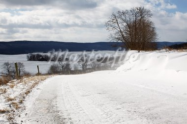 Snow blowing over a rural Pennsylvania road. Stock Photo - Royalty-Free, Artist: lehman                        , Code: 400-05911862