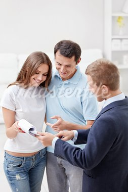 Consultant paper shows a couple at home Stock Photo - Royalty-Free, Artist: Deklofenak                    , Code: 400-05914415