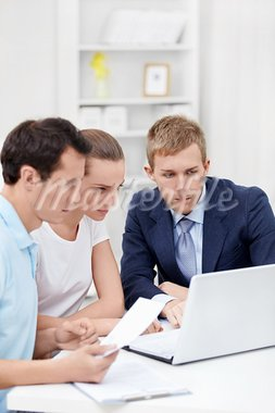 The consultant and the young couple for a laptop Stock Photo - Royalty-Free, Artist: Deklofenak                    , Code: 400-05914422