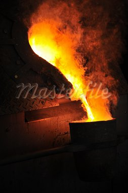 Foundry - molten metal poured from ladle for casting Stock Photo - Royalty-Free, Artist: brozova                       , Code: 400-05915115