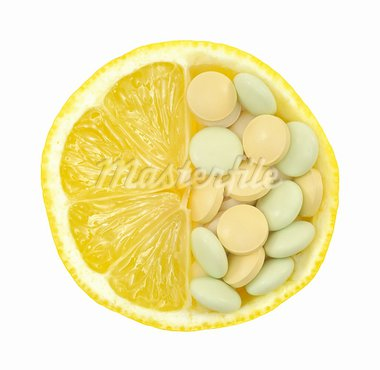 Close up of lemon and pills isolated - vitamin concept - vitamin c Stock Photo - Royalty-Free, Artist: brozova                       , Code: 400-05917120