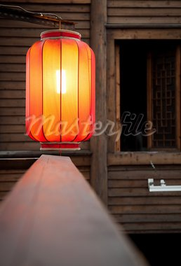 Hanging red lantern on the traditional wooden wall background Stock Photo - Royalty-Free, Artist: rodho                         , Code: 400-05928833